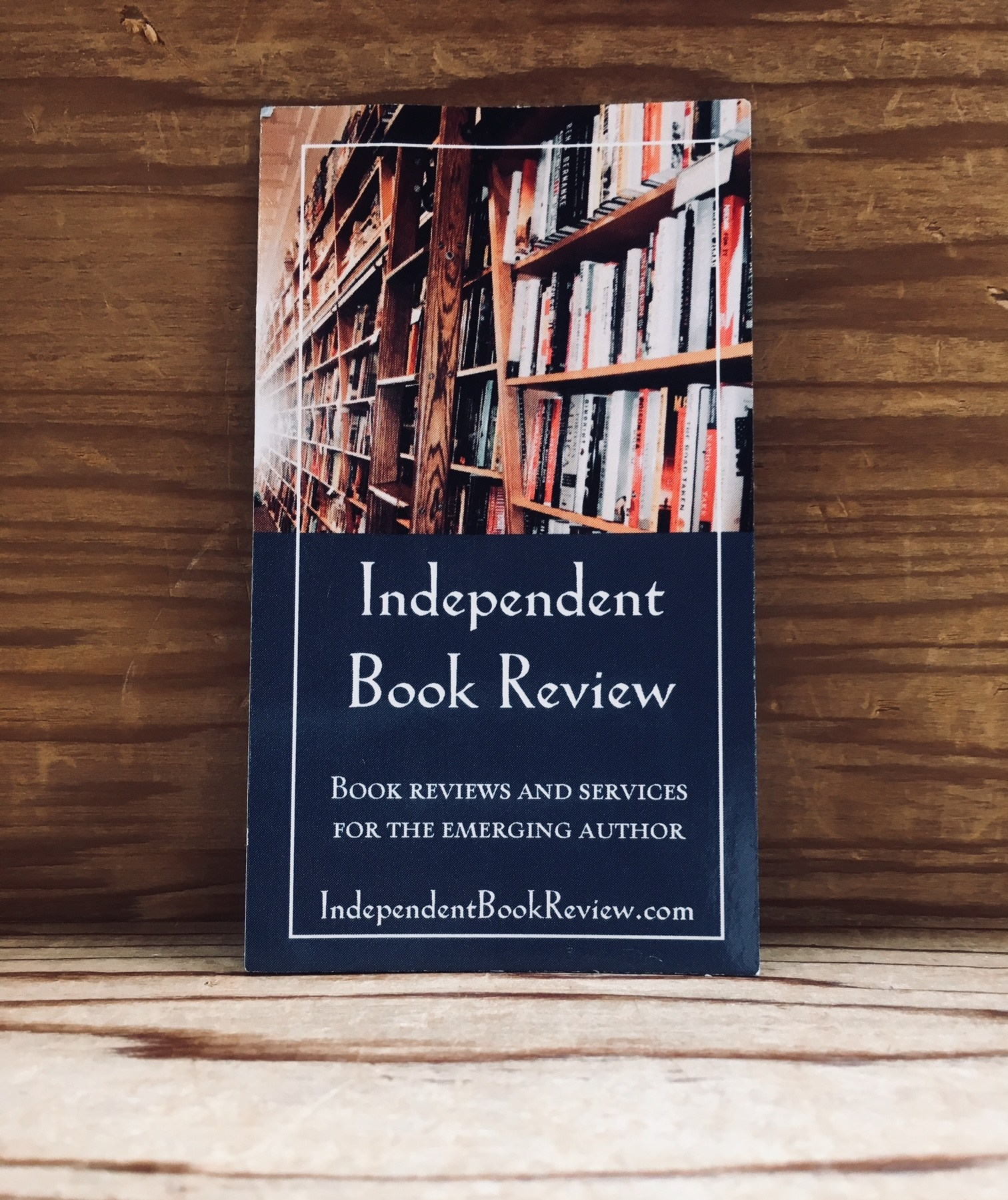 This is a picture of an Independent Book Review business card.